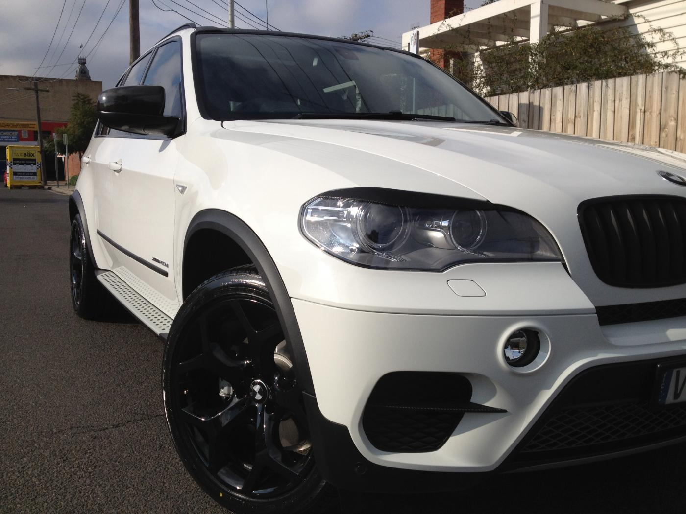 my new white x5 40d with some carbon fibre wrapping attached images